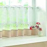 Napraforgómintás vitrázs függöny.